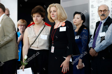 Rachael Pacella, Andrea Chamblee. Capital Gazette journalist Rachael Pacella, left, stands with Andrea Chamblee, widow of Capital Gazette journalist John McNamara, at a rededication of the Newseum's Journalists Memorial in Washington, . McNamara, who was killed by a gunman who attacked the paper's newsroom in June 2018, was one of 21 journalists' names that were added to represent all journalists who lost their lives around the world in 2018