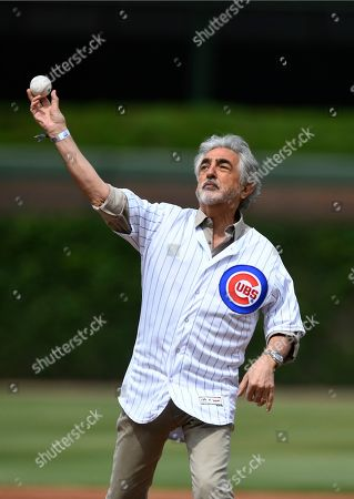 Actor Joe Mantegna throws out a ceremonial first pitch before a baseball game between the Chicago Cubs and Los Angeles Angels, in Chicago