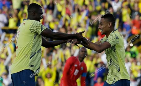 Colombia's William Tesillo, right, is congratulated by teammate Cristian Zapata after scoring a goal during a friendly soccer match against Panama at El Campin stadium in Bogota, Colombia