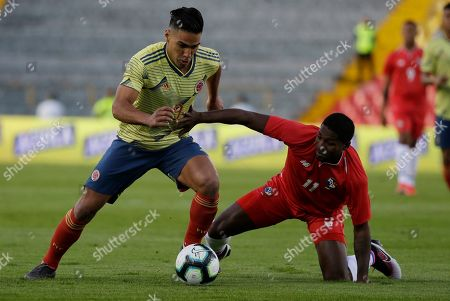 Colombia's Falcao Garcia, left, fights for the ball with Panama's Armando Cooper during a friendly soccer match at El Campin stadium in Bogota, Colombia