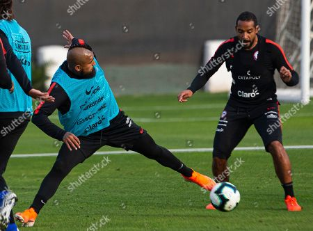 Chile's soccer player Arturo Vidal controls the ball next to Jean Beausejour during a training session in Santiago, Chile, ahead of the Copa America in neighboring Brazil