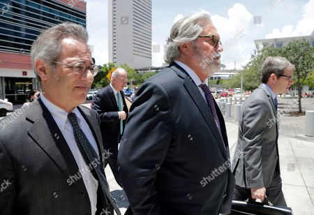 Stock Picture of Carnival Corp. Chairman Micky Arison, center, arrives at federal court, in Miami. Carnival Corp. reached a settlement with federal prosecutors in which the world's largest cruise line agreed to pay a $20 million penalty for its ships continuing to pollute the ocean despite promising years ago to stop