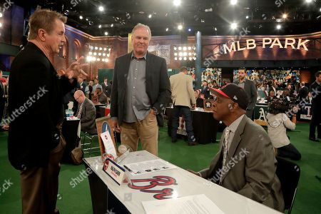 Former professional baseball players, from left to right, Ron Cey, Ryne Sandberg and Ralph Garr talk prior to the first round of the Major League Baseball draft, in Secaucus, N.J
