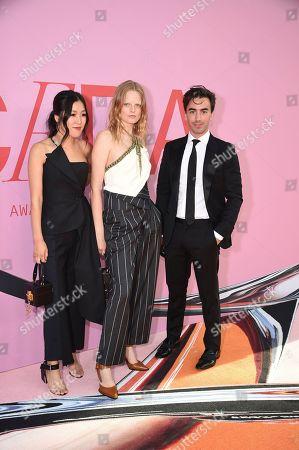 Laura Kim, Hanne Gaby Odiele, Fernando Garcia attend the CFDA Fashion Awards at the Brooklyn Museum, in New York
