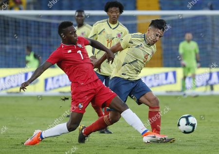 Falcao Garcia (R) of Colombia in action against Jose Luis Rodriguez (L) of Panama during a friendly match between the national soccer teams of Colombia and Panama, at El Campin Stadium in Bogota, Colombia, 03 June 2019.