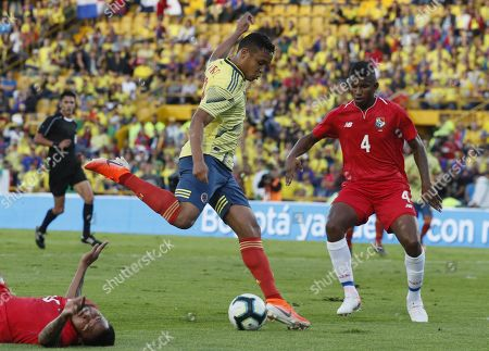 Stock Picture of Luis Muriel (L) of Colombia in action against Fidel Escobar (R) of Panama during a friendly match between the national soccer teams of Colombia and Panama, at El Campin Stadium in Bogota, Colombia, 03 June 2019.