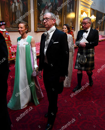 Lindsay Reynolds and the Prime Minister's husband Philip May arrive through the East Gallery during the State Banquet at Buckingham Palace, London, on day one of the US President's three day state visit to the UK