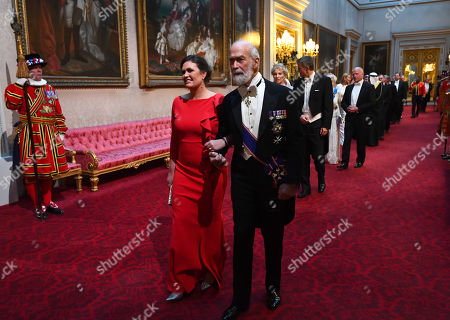 Sarah Huckabee Sanders and Prince Michael of Kent arrive through the East Gallery during the State Banquet at Buckingham Palace, London, on day one of the US President's three day state visit to the UK