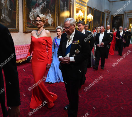Ms Emma Walmsley and the Duke of Gloucester arrive through the East Gallery during the State Banquet at Buckingham Palace, London, on day one of the US President's three day state visit to the UK