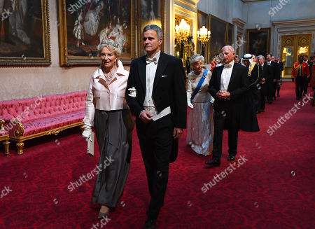 Princess Michael of Kent and Helge Lund arrive through the East Gallery during the State Banquet at Buckingham Palace, London, on day one of the US President's three day state visit to the UK