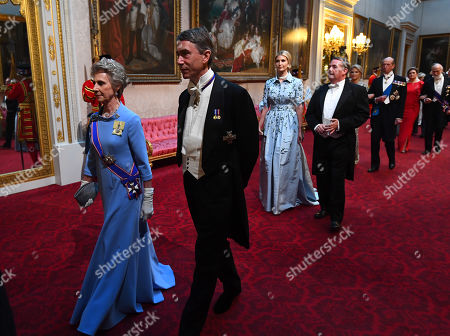 The Duchess of Gloucester and the Lord Great Chamberlain arrive through the East Gallery during the State Banquet at Buckingham Palace, London, on day one of the US President's three day state visit to the UK