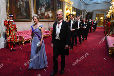Sophie Countess of Wessex and the Chancellor of the Duchy of Lancaster, David Lidington arrive through the East Gallery during the State Banquet at Buckingham Palace, London, on day one of the US President's three day state visit to the UK