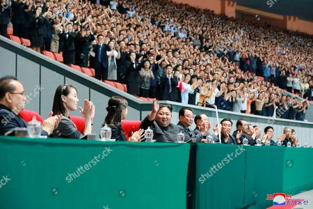 "Provided on Tuesday, June 4, 2019, by the North Korean government, North Korean leader Kim Jong Un, center, waves with his wife Ri Sol Ju, center left, during the grand gymnastics and artistic performance at the May Day Stadium in Pyongyang. The woman next to Ri Sol Ju appears to be Kim's sister, Kim Yo Jong, who state media said attended the performance. Independent journalists were not given access to cover the event depicted in this image distributed by the North Korean government. The content of this image is as provided and cannot be independently verified. Korean language watermark on image as provided by source reads: ""KCNA"" which is the abbreviation for Korean Central News Agency"