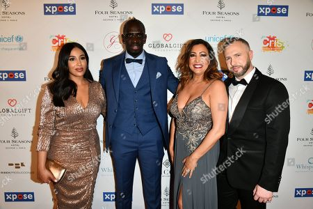 Mamadou Sakho with his wife, Maria Bravo and guest