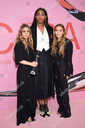 Ashley Olsen, Jessica Williams, Mary-Kate Olsen. Jessica Williams, center, poses with winners Ashley Olsen, left, and Mary-Kate Olsen in the winner's walk with the Accessory designer of the year award at the CFDA Fashion Awards at the Brooklyn Museum, in New York