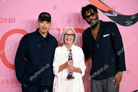 Dao-Yi Chow, Eileen Fischer, Maxwell Osborne. Public School designers Dao-Yi Chow, left, and Maxwell Osborne, right, pose with honoree Eileen Fischer in the winner's walk with the Positive Change Award at the CFDA Fashion Awards at the Brooklyn Museum, in New York