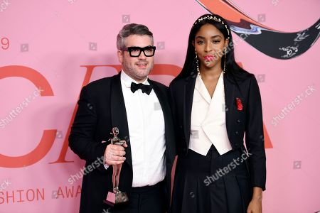 Brandon Maxwell; Jessica Williams. Brandon Maxwell, left, poses in the winner's walk with the award for Womenswear Designer of the Year with Jessica Williams at the CFDA Fashion Awards at the Brooklyn Museum, in New York