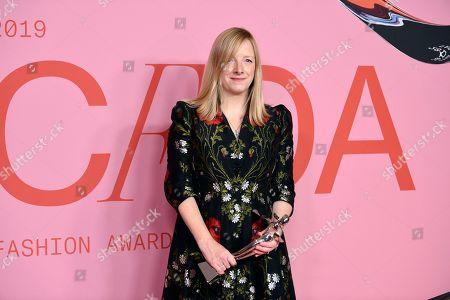 Sarah Burton poses in the winner's walk with the Valentino Garavani and Giancarlo Giammetti International Award at the CFDA Fashion Awards at the Brooklyn Museum, in New York