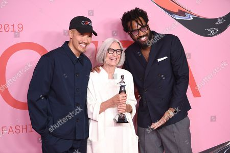 Stock Image of Dao-Yi Chow, Eileen Fischer, Maxwell Osborne. Public School designers Dao-Yi Chow, left, and Maxwell Osborne, right, pose with honoree Eileen Fischer in the winner's walk with the Positive change award at the CFDA Fashion Awards at the Brooklyn Museum, in New York