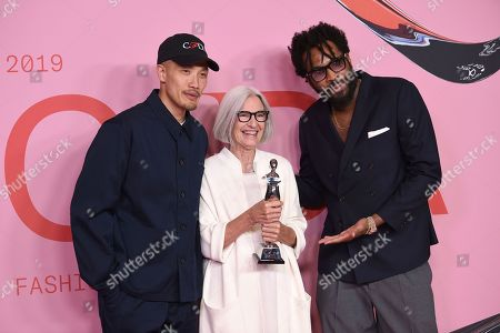 Stock Photo of Dao-Yi Chow, Eileen Fischer, Maxwell Osborne. Public School designers Dao-Yi Chow, left, and Maxwell Osborne, right, pose with honoree Eileen Fischer in the winner's walk with the Positive change award at the CFDA Fashion Awards at the Brooklyn Museum, in New York