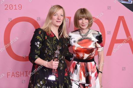 Sarah Burton, Anna Wintour. Honoree Sarah Burton poses in the winner's walk with the Valentino Garavani and Giancarlo Giammetti international award with Anna Wintour at the CFDA Fashion Awards at the Brooklyn Museum, in New York