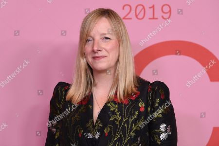 Sarah Burton poses in the winner's walk with the Valentino Garavani and Giancarlo Giammetti international award at the CFDA Fashion Awards at the Brooklyn Museum, in New York