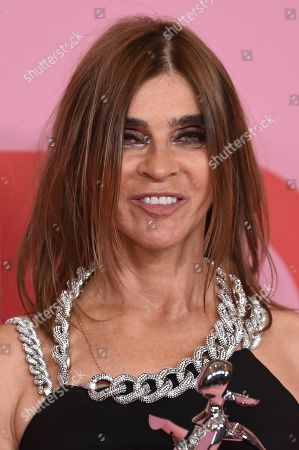 Carine Roitfeld poses in the winner's walk with the Founder's award in honor of Eleanor Lambert at the CFDA Fashion Awards at the Brooklyn Museum, in New York