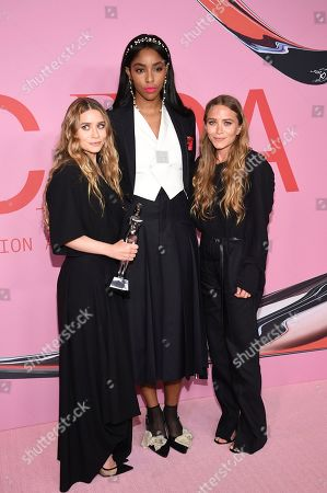 Ashley Olsen, Jessica Williams, Mary- Kate Olsen. Jessica Williams, center, poses with winners Ashley Olsen, left, and Mary- Kate Olsen in the winner's walk with the Accessory designer of the year award at the CFDA Fashion Awards at the Brooklyn Museum, in New York