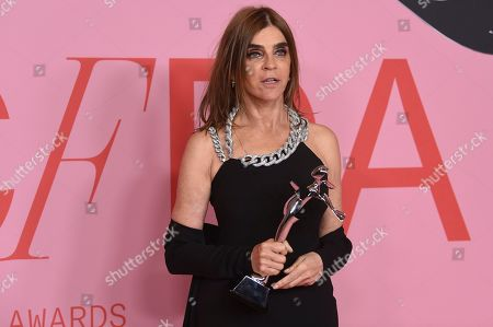 Stock Picture of Carine Roitfeld poses in the winner's walk with the Founder's award in honor of Eleanor Lambert at the CFDA Fashion Awards at the Brooklyn Museum, in New York
