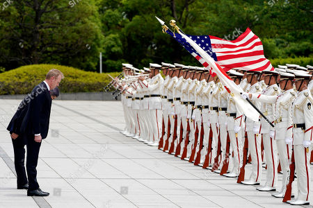 Acting US Defense Secretary Patrick Shanahan (2-L) and Japanese defense minister Takeshi Iwaya (L) bow to national flags as they inspect an honor guard ahead of their meeting at the Ministry of Defense in Tokyo, Japan, 04 June 2019. Shanahan is in Japan on an Asian tour after visiting Indonesia, Singapore and South Korea.