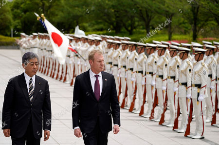 Acting US Defense Secretary Patrick Shanahan (C) and Japanese defense minister Takeshi Iwaya (L) inspect an honor guard ahead of their meeting at the Ministry of Defense in Tokyo, Japan, 04 June 2019. Shanahan is in Japan on an Asian tour after visiting Indonesia, Singapore and South Korea.