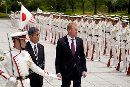 Acting US Defense Secretary Patrick Shanahan (C) and Japanese defense minister Takeshi Iwaya (C-L) inspect an honor guard ahead of their meeting at the Ministry of Defense in Tokyo, Japan, 04 June 2019. Shanahan is in Japan on an Asian tour after visiting Indonesia, Singapore and South Korea.