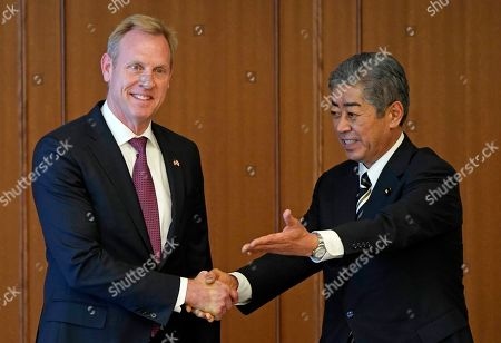 Acting US Defense Secretary Patrick Shanahan (L) and Japanese Defense Minister Takeshi Iwaya (R) shake hands prior to their meeting at the Ministry of Defense in Tokyo, Japan, 04 June 2019. Shanahan is in Japan on an Asian tour after visiting Indonesia, Singapore and South Korea.