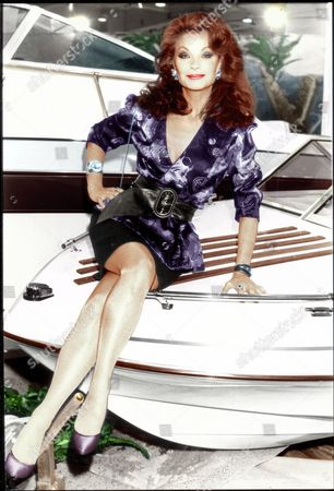 Kate O'mara - Actress (this Picture Was Used Coloured In By The Art Department The Daily Mail 29/09/2003 See Li 1488891 For Original Black And White) The Latest Beauty To Sail Down Howards' Way Charted A Change Of Course For The Top Bbc Soap Yesterday. Kate O'mara Is Joining The Series Which Reflects The Lives And Loves Of The Yachting World As It Moves Out Of Its Home Port Of Hamble Hampshire To Drop Anchor In Malta. Two Of The Show's Bitter Rivals Charles Frere And Ken Masters Are Involved In Big Deals On The Island In A Series To Be Filmed Next Month. Kate (above) Will Play A 'ruthless Hard-headed Woman Who Survives In A Male-dominated Business ' Before Returning To Hollywood - 'maybe For A Major Movie.' Yesterday She Was Her Normal Glamorous Self Meeting Malta's Leaders At The 35th International Boat Show In Earl's Court West London. Malta's Government Has Sponsored The Show's Showpiece Feature - A Recreation Of Valletta Harbour And Today Prime Minister Dr Edward Fenech-adami Will Open The Show Organised For The First Time By The British Marine Industry Federation. Among The 600 Boats On Display Is Another Howards' Way Star - The Cruiser Orkadian Of Tarrant Which Is Owned By Glyn Owen Who Plays Jack Rolfe. 1.89...actress...london...london...united Kingdom