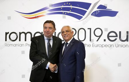 Luis Planas Puchades, Minister for Agriculture, Fisheries and Food of Spain (L), is welcomed by Romanian Agriculture Minister Petre Daea (R) at an Informal Council of the Ministers of Agriculture and Fisheries held at Parliament Palace in Bucharest, Romania, 04 June 2019.