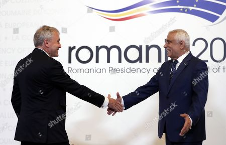 Robert Goodwill, Britain's Minister of State for Agriculture, Fisheries and Food, Department for Environment, Food and Rural Affairs (L), is welcomed by Romanian Agriculture Minister Petre Daea (R) at an Informal Council of the Ministers of Agriculture and Fisheries held at Parliament Palace in Bucharest, Romania, 04 June 2019.