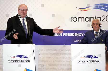 Stock Picture of Phil Hogan, European Commissioner for Agriculture and Rural Development (L) and Romanian Agriculture Minister Petre Daea (R) attend a common press conference that concluded the Informal Council of the Ministers of Agriculture and Fisheries held at Parliament Palace in Bucharest, Romania, 04 June 2019.