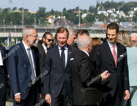 Austrian President Alexander Van Der Bellen talks with Duke Henri of Luxembourg and Swiss President Ueli Maurer talks with Prince Alois von Liechtenstein, from left, at Lentos museum in Linz, Austria