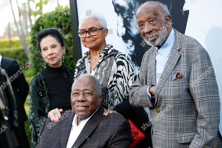 US music producer Clarence Avant (R), his wife Jacqueline Avant (L) and retired pro-baseball player Hank Aaron (front) and his wife Billye Aaron (C) arrive for the world premiere of 'The Black Godfather' at the Paramount Theater in Hollywood, Los Angeles, California, USA, 03 June 2019. The movie opens globally 07 June 2019.