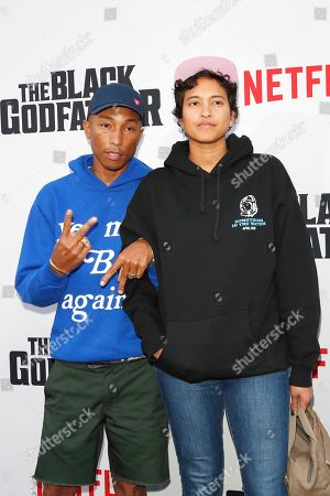 Pharrell Williams (L) and his wife Helen Lasichanh arrive for the world premiere of 'The Black Godfather' at the Paramount Theater in Hollywood, Los Angeles, California, USA, 03 June 2019. The movie opens globally 07 June 2019.