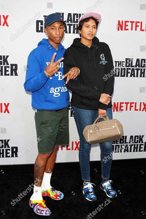 Stock Photo of Pharrell Williams (L) and his wife Helen Lasichanh arrive for the world premiere of 'The Black Godfather' at the Paramount Theater in Hollywood, Los Angeles, California, USA, 03 June 2019. The movie opens globally 07 June 2019.