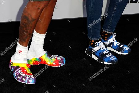 The shoes of US musician Pharrell Williams (L) and his wife Helen Lasichanh as they arrive for the world premiere of 'The Black Godfather' at the Paramount Theater in Hollywood, Los Angeles, California, USA, 03 June 2019. The movie opens globally 07 June 2019.
