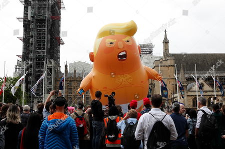 An inflatable blimp depicting President Trump as a baby in a nappy is inflated on Parliament Square. On the 2nd day of President Trump's State Visit to the UK he is meeting outgoing Prime Minister Theresa May before attending 75th Anniversary of D-Day commemorations in Portsmouth and France tomorrow.