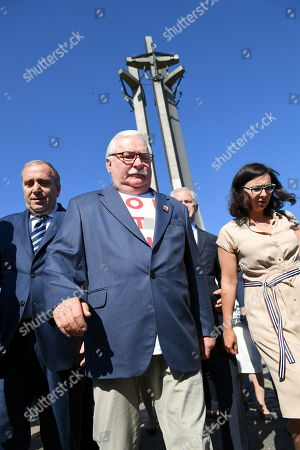 Former Polish President and Nobel Peace Prize Laureate Lech Walesa (C), leader of the main opposition party, the Civic Platform (PO) Grzegorz Schetyna (L) and member of the the Sejm (lower house of the Parliament) Kamila Gasiuk-Pihowicz (R) lay flowers at the Monument to the Fallen Shipyard Workers of 1970 in Gdansk, Poland, 04 June 2019. Poland celebrates 30th anniversary of the country's first partially-free parliamentary elections since WWII.