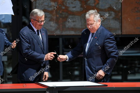 Former Polish presidents Bronislaw Komorowski (L) and Aleksander Kwasniewski (R) sign the proclamation of the 'Declaration of Freedom and Solidarity' in front of the Monument to the Fallen Shipyard Workers of 1970 at Solidarity Square in Gdansk, Poland, 04 June 2019. Poland celebrates the 30th anniversary of the country's first partially-free parliamentary elections since WWII.