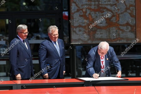 Former Polish presidents Lech Walesa (R), Bronislaw Komorowski (L) and Aleksander Kwasniewski (C) sign the proclamation of the 'Declaration of Freedom and Solidarity' in front of the Monument to the Fallen Shipyard Workers of 1970 at Solidarity Square in Gdansk, Poland, 04 June 2019. Poland celebrates the 30th anniversary of the country's first partially-free parliamentary elections since WWII.