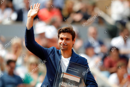 Spain's David Ferrer greets spectators after a tribute marking his retirement, at the French Open tennis tournament at the Roland Garros stadium in Paris