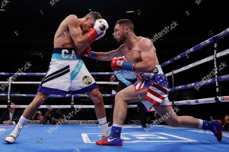 Stock Picture of England's Tommy Coyle, left, punches Chris Algieri during the first round of a WBO International junior welterweight championship boxing match, in New York. Algiere stopped Coyle in the eighth round