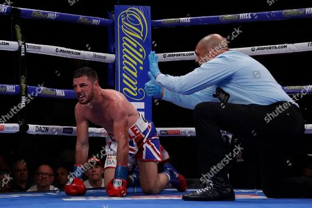England's Tommy Coyle reacts as the referee counts after he was knocked down by Chris Algieri during the fourth round of a WBO International junior welterweight championship boxing match, in New York. Algiere stopped Coyle in the eighth round