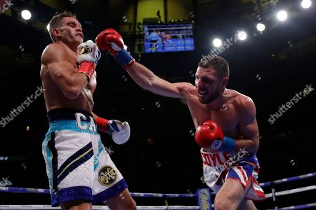 England's Tommy Coyle, right, punches Chris Algieri during the fourth round of a WBO International junior welterweight championship boxing match, in New York. Algiere stopped Coyle in the eighth round